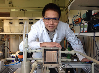 Jeff with a prototype multi-effect membrane desalination  developed for the High Concentration PhotoVoltaic Thermal  system