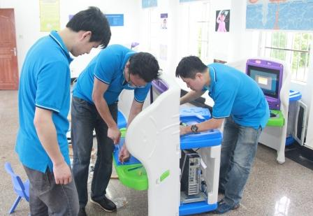 IBM volunteers assemble KidSmart computer learning centers