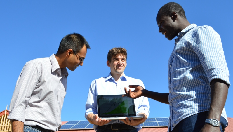 Chris discusses the solar energy curve with IBM Scientists Arun Vishwanath and Julian de Hoog in Australia""